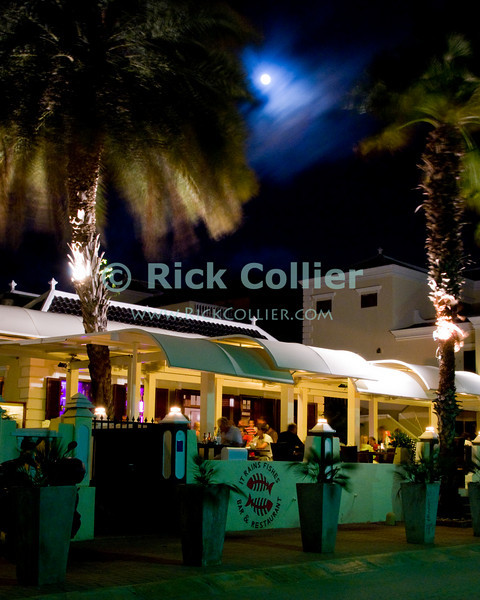 "Kralendijk, Bonaire, Netherland Antilles -- The moon illuminates one of the many waterfront restaurants and bars in Kralendijk.   © Rick Collier<br /> <br /> <br /> <br /> <br /> Bonaire; ""Netherlands Antilles""; Caribbean; tropic; tropical; vacation; destination; Kralendijk; night; moon; bar; entertainment; waterfront; street; ""street scene"";"