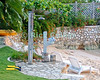 Amanoka Villa, Discovery Bay, Saint Ann Parish, Jamaica.  A shower and everything you need stands ready near the beach at this tropical island paradise.  © Rick Collier<br /> <br /> <br /> <br /> <br /> <br /> Jamaica Discovery Bay Dry Harbor Bay Amanoka Villa tropical island paradise beach summer fun relaxation wall swim fins lounge chair path grass shower totem pole