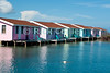 Cabanas, Hugh Parkey Dive Connection, Belize.  Small guest cottages are perched on stilts overlooking the beautiful blue and green waters of Spanish Lookout Caye, near Belize City and Turneffe Atoll, Belize.  © Rick Collier
