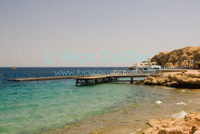 Sharm el-Sheikh, the Sinai, Egypt.  The docks stand empty at noon, waiting for the daily crush of dive and excursion boats that all share this one facility.  © Rick Collier<br /> <br /> <br /> <br /> <br /> <br /> Egypt 'Red Sea' 'Ras Mohammed' Sharm 'Sharm el-Sheikh' 'Sharm al-Shaykh' seashore Sinai arab sea view hotel tourist tourism dock pier shore boat