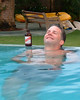 Amanoka Villa, Discovery Bay, Jamaica.  Enjoying an afternoon beer after a long day of kayaking, sunning, and swimming in Discovery Bay.  © Rick Collier<br /> <br /> <br /> <br /> <br /> <br /> Jamaica Discovery Bay Amanoka Villa tropical island paradise beach summer fun relaxation swimming pool red stripe beer smiling cool swim Rick