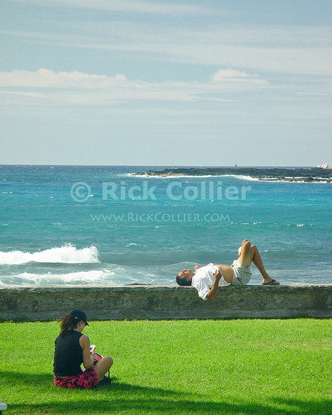 Office workers take their lunch break near the ocean.  Kona, the Big Island, Hawaii.<br /> <br /> <br /> <br /> <br /> <br /> <br /> Hawaii Hawai'i Kona big island beach sea ocean sun rest relax relaxation lunch break