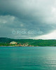 Amanoka Villa, Discovery Bay, Saint Ann Parish, Jamaica.  Dramatic clouds mark the leading edge of a storm front, reflecting off the calm waters of the bay.  © Rick Collier<br /> <br /> <br /> <br /> <br /> <br /> Jamaica Discovery Bay Dry Harbor Bay Amanoka Villa tropical island paradise beach summer fun relaxation storm front clouds reflection