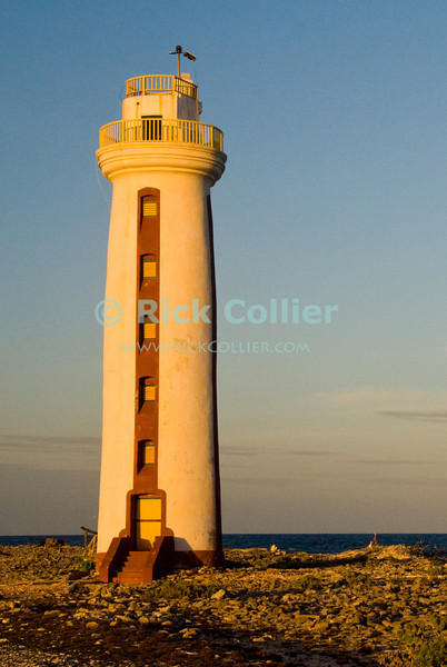 """Bonaire, Netherland Antilles -- Willemstoren lighthouse stands alone at the southernmost end of Bonaire.   © Rick Collier<br /> <br /> <br /> <br /> <br /> Bonaire; """"Netherlands Antilles""""; Caribbean; tropic; tropical; vacation; destination; light; lighthouse; sea; ocean; seashore; view; Willemstoren; """"Willemstoren lighthouse"""";"""