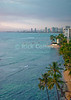 Evening sunlight illuminates the bay at Waikiki, Honolulu, Oahu, Hawaii.  © Rick Collier<br /> <br /> <br /> <br /> <br /> <br /> <br /> <br /> Hawaii Hawai'i Oahu Honolulu Waikiki beach bay boats city skyline seashore evening