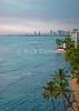 Evening sunlight illuminates the bay at Waikiki, Honolulu, Oahu, Hawaii.  © Rick Collier<br /> <br /> <br /> <br /> <br /> <br /> <br /> <br /> Hawaii Hawai'i Oahu Honolulu Waikiki beach bay boats city skyline seashore evening