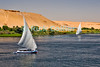 "Nile River, Egypt -- Feluccas sail on the Nile River near Aswan. © Rick Collier / RickCollier.com.<br /> <br /> <br /> <br /> travel; vacation; tour; tourism; tourist; destination; Egypt; boat; boats; sailboat; shore; river; Nile; ""Nile River""; sail; sailing; felucca; Aswan"