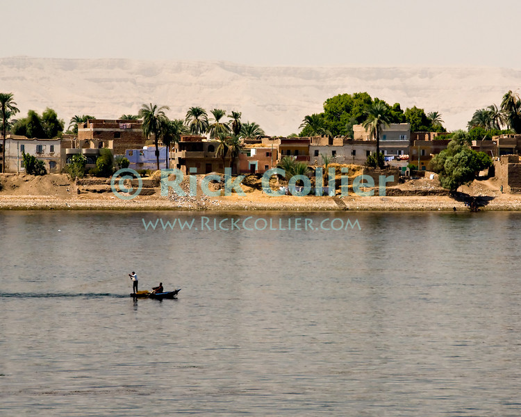 "Nile River, Egypt -- A fisherman hauls his nets in the Nile River (near Luxor, Egypt). © Rick Collier / RickCollier.com.<br /> <br /> <br /> <br /> <br /> <br /> <br /> travel; vacation; tour; tourism; tourist; destination; Egypt; Nile; ""Nile River""; boat; town; fishing; fisherman;"