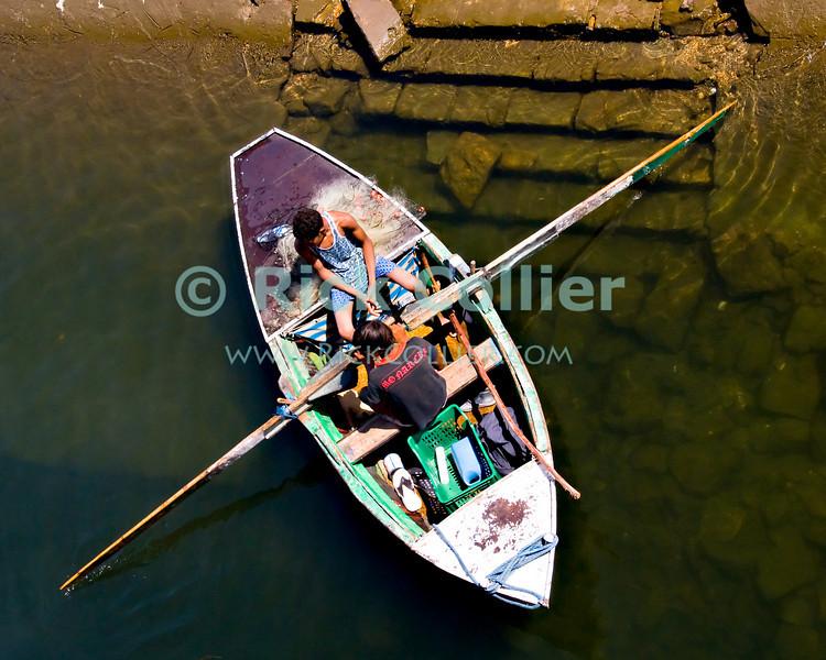 "Nile River, Egypt -- Boys launch a small rowboat in the Nile River (near Luxor, Egypt). © Rick Collier / RickCollier.com.<br /> <br /> <br /> <br /> <br /> <br /> <br /> travel; vacation; tour; tourism; tourist; destination; Egypt; Nile; ""Nile River""; boat; steps; shore;"