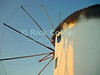 Mikonos, Greece.  A windmill catches the warm sunset light.  © Rick Collier<br /> <br /> <br /> <br /> <br /> <br /> <br /> Greece Mikonos Mykonos Greek tour tourist tourism windmill sunset thatch