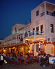 Mikonos, Greece.  Tavernas, restaurants, and cafes line the waterfront around Mikonos harbor.  © Rick Collier<br /> <br /> <br /> <br /> <br /> <br /> <br /> Greece Mikonos Mykonos tour tourist tourism small Greek tavern taverna restaurant cafe food