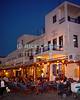 Mikonos, Greece.  Tavernas, restaurants, and cafes line the waterfront around Mikonos harbor.  © Rick Collier<br /> <br /> <br /> <br /> <br /> <br /> <br /> Greece Mikonos Mykonos tour tourist tourism small Greek tavern taverna restaurant cafe food