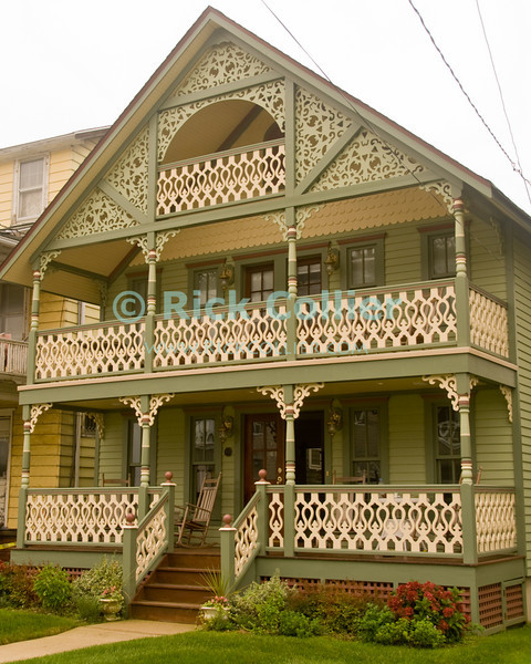 """""""House"""" - Beautiful trimwork lines the railings, decks, balconies, and eves of this family home near the beach at Ocean Grove, New Jersey, USA.<br /> <br /> <br /> USA """"New Jersey"""" NJ """"Ocean Grove"""" Ocean Grove Ocean Avenue beach block homes houses trim scrollwork railing rails porch deck eves roof facade decor"""