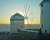 Mikonos, Greece.  The famous thatch-roofed windmills of Mikonos are silhouetted by the sunset.  © Rick Collier<br /> <br /> <br /> <br /> <br /> <br /> <br /> Greece Mikonos Mykonos Greek tour tourist tourism ocean view Aegean Sea windmill sunset thatch roof