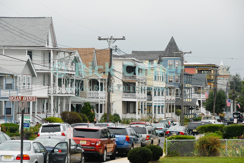 """Guest Houses"" - Large homes, inns, and B&Bs line dominate the streets near the beach at Ocean Avenue in Ocean Grove, New Jersey, USA.<br /> <br /> <br /> USA ""New Jersey"" NJ ""Ocean Grove"" Ocean Grove Ocean Avenue beach block homes houses yard trim crowded close guests inn inns B&B multistorey car park cars street scene"