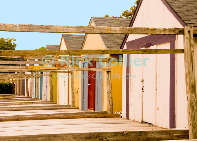 """""""Beach Shacks"""" - Where once there were seasonal tents, some have now built wooden """"shacks"""" where they can stay when visiting the beach in summer.<br /> <br /> <br /> USA """"New Jersey"""" NJ """"Ocean Grove"""" Ocean Grove sidewalk shack tent camping seasonal summer stay lodging property poles posts doors color colorful colors deck decks wood frame framework"""