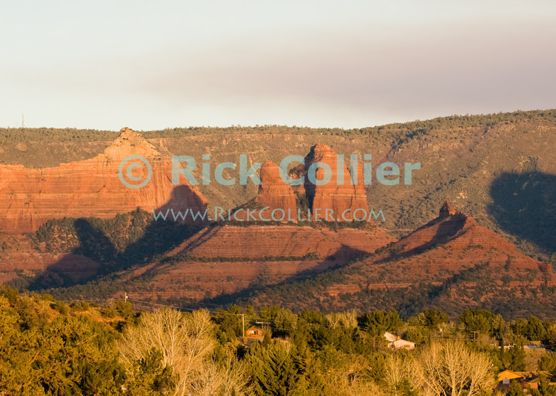 Sedona, Arizona.  Sedona sits in a valley, surrounded by picturesque rock formations, buttes, and mesas.  © Rick Collier<br /> <br /> <br /> <br /> <br /> <br /> <br /> <br /> US USA Arizona Sedona hiking trail desert tree trees rest calm relax serene scenic view red sand red rocks rocky mesa butte mountain cliff cliffs