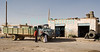 """Truck Stop"" -- A garage by the side of the ""desert highway,"" south of Amman Jordan.  © Rick Collier<br /> <br /> <br /> <br /> Jordan truck 'truck stop' garage repair arab driver bedouin arab mechanic wheel arabic country desert tire tires"
