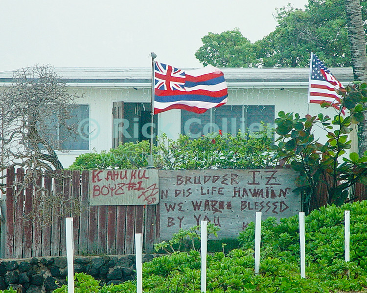 The home of a Hawaiian native, flying the Hawaiian flag, laments the loss of famed Hawaiian singer Israel Kamakawiwo'ole (Brother Iz).  Windward Side, Kahuku, Oahu, Hawaii.  © Rick Collier<br /> <br /> <br /> <br /> <br /> <br /> <br /> Hawaii Hawai'i Hawaiian Oahu Kahuku windward side Iz Israel Kamakawiwo'ole home homestead flag