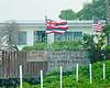 The home of a Hawaiian native, flying the Hawaiian flag, laments the loss of famed Hawaiian singer Israel Kamakawiwo'ole (Brother Iz).  Windward Side, Kahuku, Oahu, Hawaii.  © Rick Collier<br /> <br /> <br /> <br /> <br /> <br /> <br /> Hawaii Hawai'i Hawaiian Oahu Kahuku windward side Iz Israel Kamakawiwo'ole home homestead flag