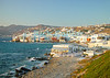 Mikonos, Greece.  A small cafe that has been used in several movies (including the conclusion of 'The Bourne Identity') overlooks colorful Mikonos houses, cafes, and restaurants that stand directly at the sea's edge.  © Rick Collier<br /> <br /> <br /> <br /> <br /> <br /> <br /> Greece Mikonos Mykonos Greek balcony door window shutter alley alleyway overlook ocean view Aegean Sea waterfront bar beach sunset diner tour tourist tourism