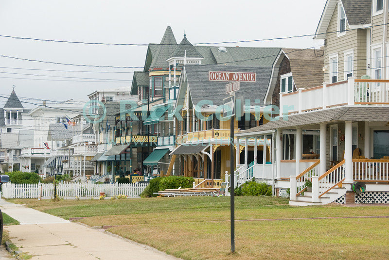 """Ocean Avenue"" - Large homes line the streets in the beach block near Ocean Avenue.  Ocean Grove, New Jersey, USA.<br /> <br /> <br /> USA ""New Jersey"" NJ ""Ocean Grove"" Ocean Grove Ocean Avenue beach block homes houses yard trim crowded close"