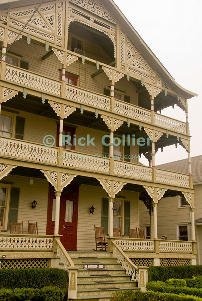 """""""Family Retreat"""" - Beautiful trimwork lines the railings, decks, balconies, and eves of this family home near the beach at Ocean Grove, New Jersey, USA.<br /> <br /> <br /> USA """"New Jersey"""" NJ """"Ocean Grove"""" Ocean Grove Ocean Avenue beach block homes houses trim scrollwork railing rails porch deck eves roof facade decor"""