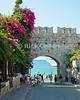 Rhodes Town, on the island of Rhodes, Greece.  A cruise ship awaits its returning passengers, visible through one of the city gates through the battlements of the city fortifications.  © Rick Collier<br /> <br /> <br /> <br /> <br /> <br /> Greece Rhodes tour tourism tourist tourists citadel fort fortress castle crusader crusaders knight knights templar templars wall walls sidewalk sidewalk street alley arch arches walk walking cruise ship