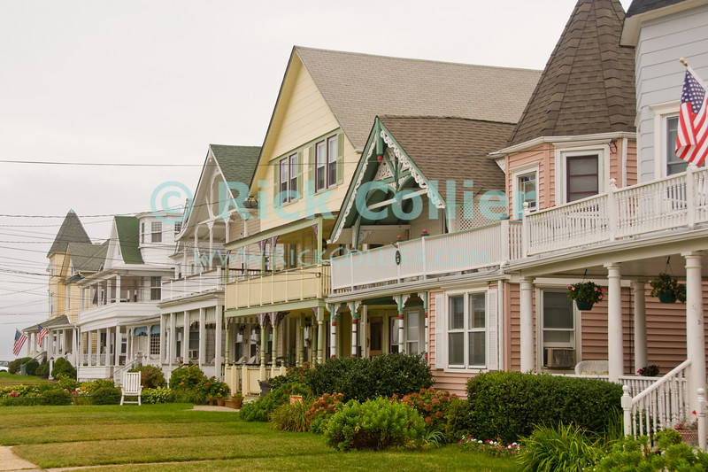 """Shore Houses"" - Nicely kept houses line a beach-block street at Ocean Grove, New Jersey, USA.<br /> <br /> <br /> USA ""New Jersey"" NJ ""Ocean Grove"" Ocean Grove sidewalk houses homes vacation summer beach block yard power lines neat decor"