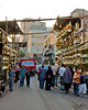 Brass vendors line the Sharia Ahmed Maher (street) in the old city, Cairo, Egypt.  Cairo residents and shoppers come and go, sharing the street with trucks and cars as they make their way home with shopping at the end of the day. © Rick Collier<br /> <br /> <br /> <br /> <br /> <br /> <br /> Egypt Egyptian Cairo tourist tourism history historic antiquities Islamic mosque 'old town' 'walled city' brass shop stall stand vendor seller pedestrian walk resident Arab workers laborer truck street road