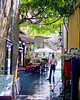 Inside the Crusader citadel, Rhodes Town, on the island of Rhodes, Greece.  A restaurant worker cleans the sidewalk in preparation for the evening's rush.  © Rick Collier<br /> <br /> <br /> <br /> <br /> <br /> Greece Rhodes tour tourism tourist tourists citadel fort fortress castle crusader crusaders knight knights templar templars pedestrian walk walking shops stores wall walls restaurant cafe cafes tavern taverna tavernas sidewalk