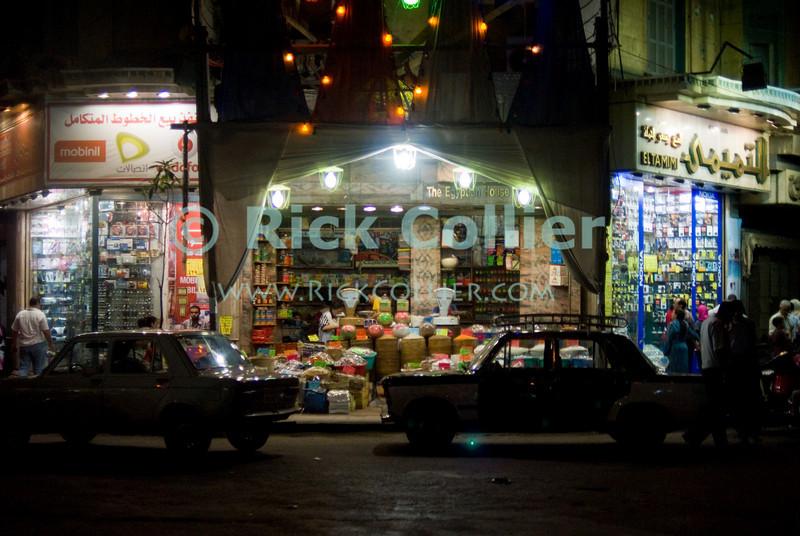 Cairo, Egypt -- Night market, Cairo. © Rick Collier / RickCollier.com.<br /> <br /> <br /> <br /> <br /> <br /> travel; vacation; tour; tourism; tourist; destination; Egypt; Cairo; night; street; market; store; shop; shoppers