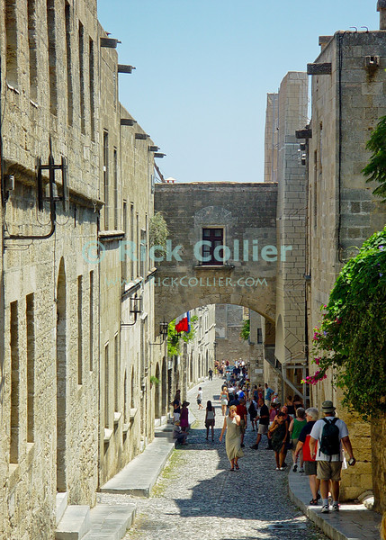 Crusader citadel, Rhodes Town, on the island of Rhodes, Greece.  A street is lined by lodging and guild halls within the citadel in the old city of Rhodes.  The citadel was build by the multinational Crusader order of the Knights Templar on the Island of Rhodes.  Eventually beseiged and then expelled by the armies of Saladin, the Templars subsequently moved to Malta.  © Rick Collier<br /> <br /> <br /> <br /> <br /> <br /> Greece Rhodes tour tourism tourist tourists citadel fort fortress castle crusader crusaders knight knights templar templars street road alley