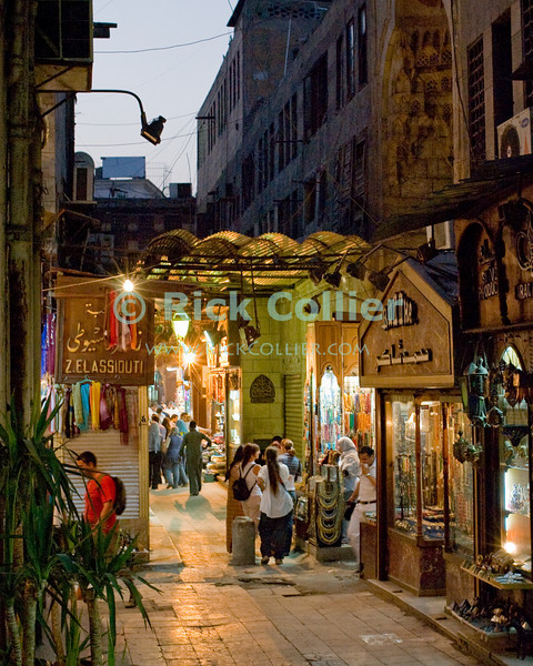The Khan el-Khalili in central Cairo was once the market terminus for caravans crossing the Sahara.  Today, it is a warren of narrow streets and alleys, crowded with restaurants, tea rooms, stalls, and shops selling everything from jewelry to clothing to souvenirs and home decorations.  © Rick Collier<br /> <br /> <br /> <br /> <br /> <br /> <br /> Egypt Cairo Khan 'Khan el-Khalili' 'Khan al-Khalili' shop store Islamic Cairo stalls stands shopping tourism tourist historic history streets 'street scene' bazaar market