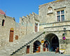 Inside the Crusader citadel, Rhodes Town, on the island of Rhodes, Greece.  Shops have taken over from soldier's lodgings and armories in the battlements.  © Rick Collier<br /> <br /> <br /> <br /> <br /> <br /> Greece Rhodes tour tourism tourist tourists citadel fort fortress castle crusader crusaders knight knights templar templars pedestrian walk walking shops stores fortification battlements wall walls