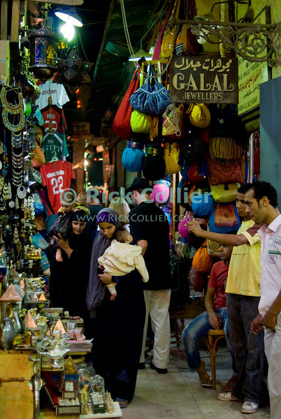 """Khan el-Khalili bazaar, Cairo, Egypt -- The famous Khan el-Khalili bazaar, spread like a warren over several blocks in downtown Cairo, is lit, crowded, and eagerly serving locals and tourists alike until late at night, nearly every night. © Rick Collier / RickCollier.com<br /> <br /> <br /> <br /> <br /> travel; vacation; destination; Egypt; Cairo; night; Khan; """"Khan el-Khalili""""; bazaar; market; marketplace; lights; shops; stalls; vendors;"""
