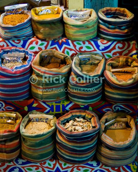 "Khan el-Khalili bazaar, Cairo, Egypt -- Spices for sale at a small stand in the Khan bazaar. © Rick Collier / RickCollier.com<br /> <br /> <br /> <br /> <br /> travel; vacation; destination; Egypt; Cairo; night; Khan; ""Khan el-Khalili""; bazaar; market; marketplace; lights; shops; stalls; shop; spice; spices; bag; bags; display"