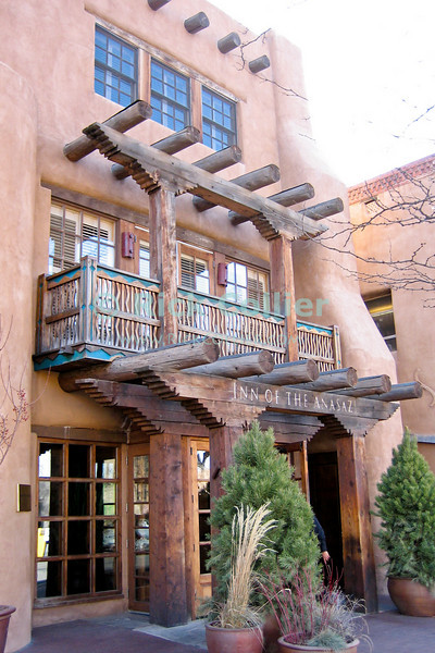 Santa Fe, New Mexico, USA.  Buildings in downtown Santa Fe are modeled in the stereotypical southwest American pueblo style.  © Rick Collier<br /> <br /> <br /> <br /> <br /> <br /> <br /> US USA New Mexico Santa Fe Inn of the Anasazi Inn door colorful decor decoration facade southwest pueblo