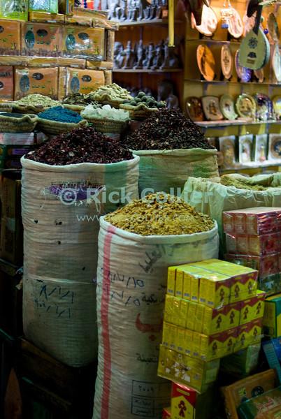 "Khan el-Khalili bazaar, Cairo, Egypt -- A grocery store displays its wares in the Khan el-Khalili bazaar. © Rick Collier / RickCollier.com<br /> <br /> <br /> <br /> <br /> travel; vacation; destination; Egypt; Cairo; night; Khan; ""Khan el-Khalili""; bazaar; market; marketplace; lights; shops; stalls; vendors; shop; food; bag; display; groceries"