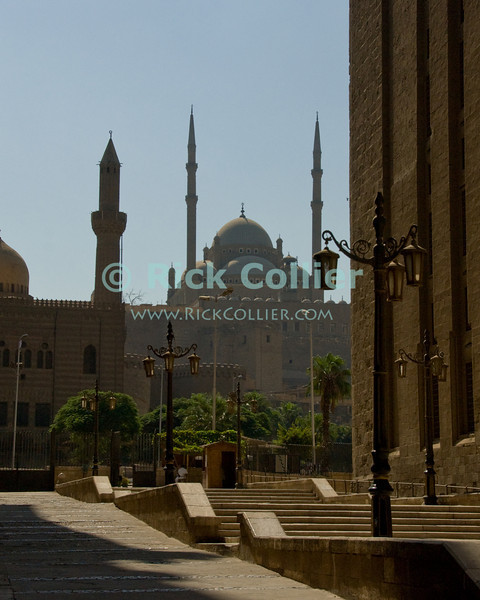 """Cairo, Egypt -- The Citadel of Saladin is an impressive sight as one exits the Sultan Hassan Mosque complex in central Cairo. © Rick Collier / RickCollier.com<br /> <br /> <br /> <br /> travel; vacation; tour; tourism; tourist; destination; Egypt; Cairo; mosque; madrassa; Sultan; Hassan; """"Sultan Hassan""""; Saladin; citadel"""
