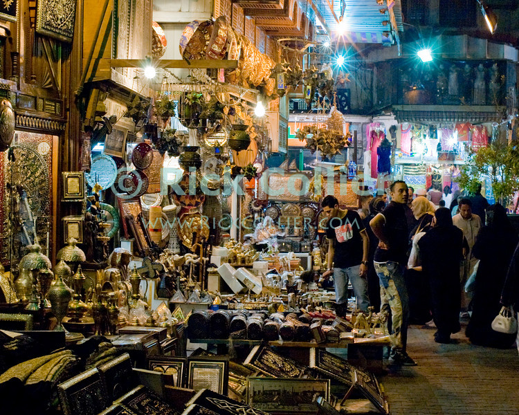 The Khan el-Khalili in central Cairo was once the market terminus for caravans crossing the Sahara.  Today, it is a warren of narrow streets and alleys, crowded with restaurants, tea rooms, stalls, and shops selling everything from jewelry to clothing to souvenirs and home decorations.  © Rick Collier<br /> <br /> <br /> <br /> <br /> <br /> <br /> Egypt Cairo Khan 'Khan el-Khalili' 'Khan al-Khalili' shop store Islamic Cairo stalls stands shopping tourism tourist historic history streets 'street scene' lights night evening bazaar market