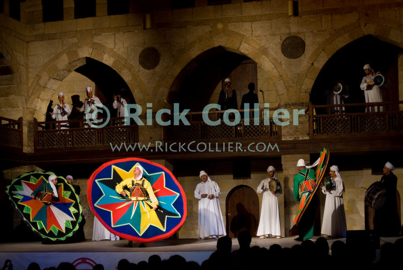 """Cairo, Egypt -- The Sufi Dervish sect puts on a """"whirling dervish"""" dance show every few nights at the Wikala al-Ghouri (the Ghourija). Accompanied by Arabic music and song, the dance is actually a religious observance, commanding total focus and movement to honor and commend devotion to the one true God. © Rick Collier / RickCollier.com.<br /> <br /> <br /> <br /> <br /> <br /> travel; vacation; tour; tourism; tourist; destination; Egypt; Cairo; al-Ghouri; wikala; """"Wikala al-Ghouri""""; dervish; Sufi; whirling; """"whirling dervish""""; dance; show; performance; night; entertainment"""