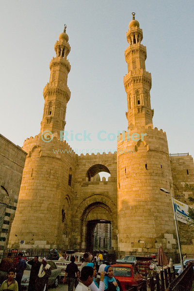 The Bab Zwayla gate to the old city, Cairo, Egypt.  Cairo residents and shoppers come and go through this gate, one of the original gates in the original walled city. © Rick Collier<br /> <br /> <br /> <br /> <br /> <br /> <br /> Egypt Egyptian Cairo tourist tourism history historic antiquities Islamic mosque 'old town' 'walled city' wall minaret gate fort fortification castle