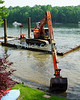 Lake Thoreau, Reston, Virgina, USA.  Every few years, the man-made lakes around Reston must be dredged.  © Rick Collier<br /> <br /> <br /> Lake Thoreau Reston Virginia dredge dredging scoop mud bottom deepen deepening construction water lake summer