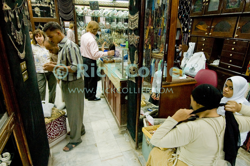 Bedouin silver shop in the Khan el-Khalili.  The Khan el-Khalili in central Cairo was once the market terminus for caravans crossing the Sahara.  Today, it is a warren of narrow streets and alleys, crowded with restaurants, tea rooms, stalls, and shops selling everything from jewelry to clothing to souvenirs and home decorations.  © Rick Collier<br /> <br /> <br /> <br /> <br /> <br /> <br /> Egypt Cairo Khan 'Khan el-Khalili' 'Khan al-Khalili' shop store Islamic Cairo stalls stands shopping tourism tourist historic history streets 'street scene' silver vendor bedouin interior inside