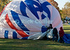 """Packing Up"" -- The ReMax crew takes down one of the more well-known balloons at the annual Winchester Balloon Festival.  Long Branch Farm, Winchester, Virginia, USA.  © RickCollier.com<br /> <br /> <br /> <br /> <br /> <br /> ""balloon festival""; USA; Virginia; Winchester; ""Long Branch""; ""Long Branch Farm""; field; tree; fence; fences; dawn; morning; dew; frost; balloon; lift; ""balloon lift""; landing; deflate; ReMax; ""Re/Max""; ""ReMax balloon"""