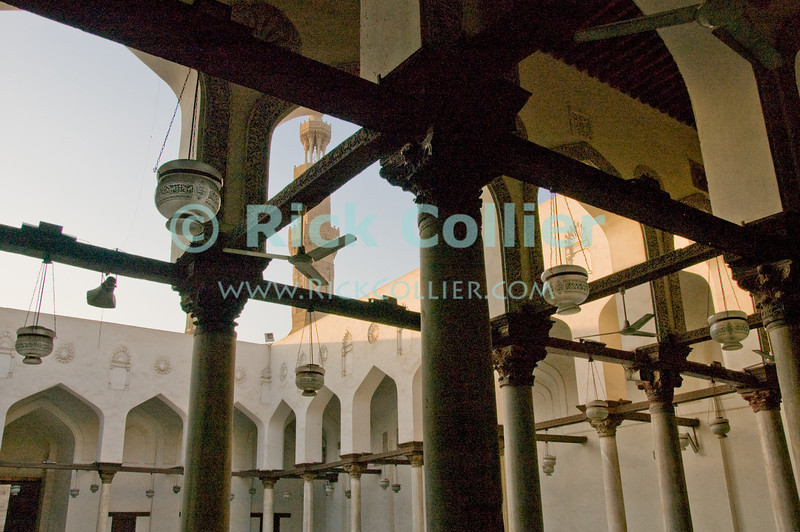 Mosque of Salih Tala'i, Cairo, Egypt.  This small mosque is one of the oldest in Islamic Cairo, standing just outside the old walled city, at the Bab Zwayla gate. © Rick Collier<br /> <br /> <br /> <br /> <br /> <br /> <br /> Egypt Egyptian Cairo tourist tourism history historic antiquities Islamic mosque 'old town' 'walled city' fan carpet beam pillar post window chandelier light arch worship religion Islam Muslim minaret