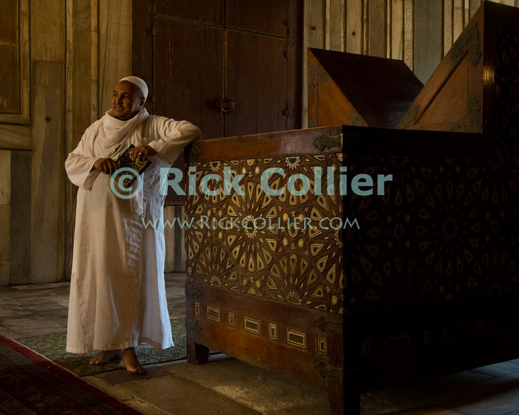 """Cairo, Egypt -- A cleric describes history and religious practice within the mausoleum of the Sultan Hassan mosque.  (Subject permission / release is available.) © Rick Collier / RickCollier.com<br /> <br /> <br /> <br /> travel; vacation; tour; tourism; tourist; destination; Egypt; Cairo; mosque; madrassa; Sultan; Hassan; """"Sultan Hassan""""; mausoleum; imam; cleric; Koran;"""