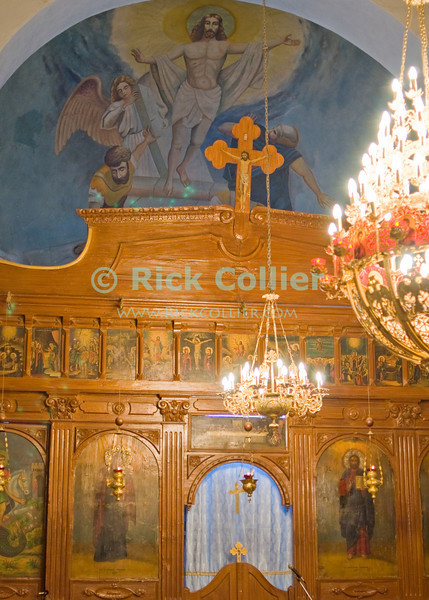 Lovely iconography beautifies the altar in St. George's Cathedral, in Madaba, Jordan. © Rick Collier<br /> <br /> <br /> <br /> <br /> Jordan Madaba church mosaic icon iconography painting Christian 'Saint George' 'St. George' 'St. George Church' 'St. George Orthodox Church' Greek Orthodox altar chandelier mosaic mosaics history historic tourist tourism fresco frescoes