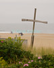 """Cross"" - Ocean Grove, New Jersey, USA, was originally a Christian religious camp.  The beach still features crosses and an open-air chapel.<br /> <br /> <br /> USA ""New Jersey"" NJ ""Ocean Grove"" Ocean Grove Christian camp cross beach bather flower"